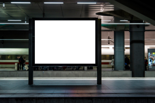 A blank billboard in a train station.